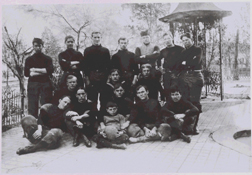 Photo of the students at the Hosptial Corps Training School in athetic gear taken near the well cover near the Northeast corner of grounds