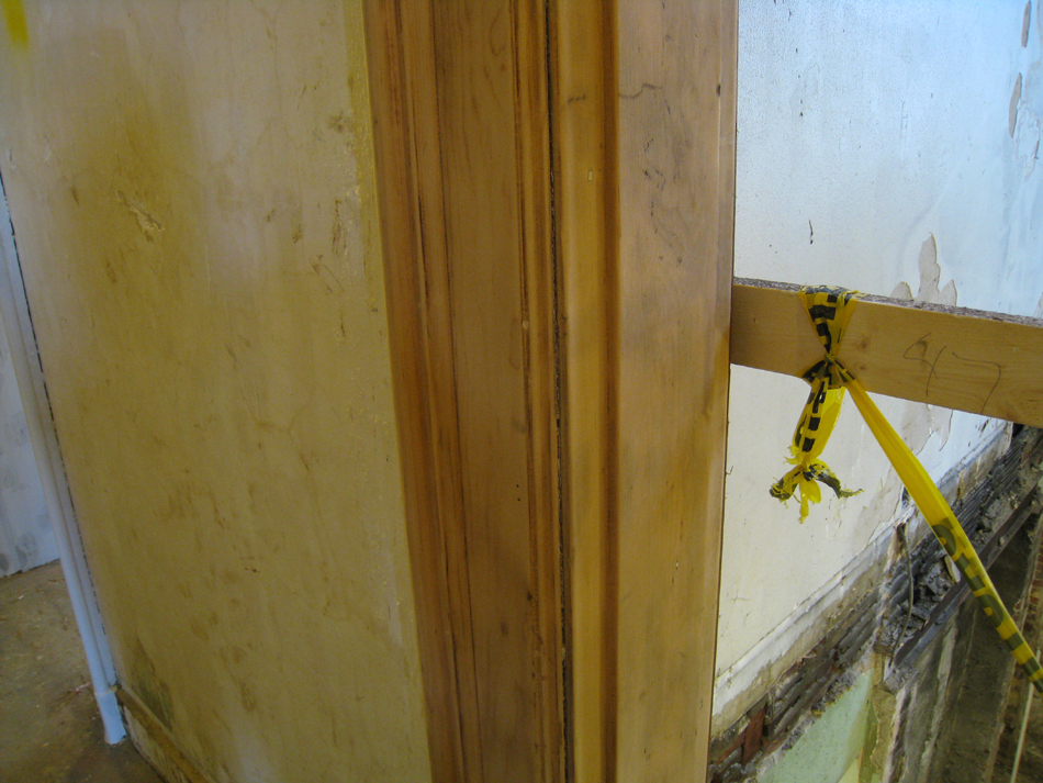 First Floor - Southwest Corner at Staircase Detail of Doorframe After Sanding