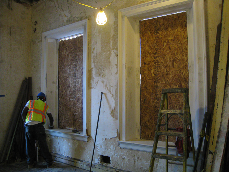 Second Floor--Priming window frames in southwest corner room