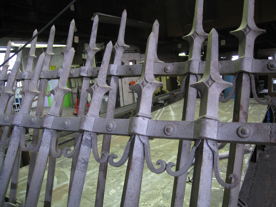 Fence - at G. Krug and Sons - detail of fillets (scrolls) and top spears after sandblasting.
