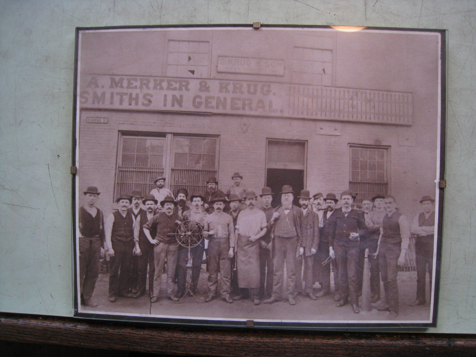 Fence - at G. Krug and Sons - 1880's photo of workers at G. Krug with Gustav Krug framed in doorway.