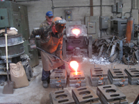 Fence -- Swiss Foundry -- pouring metal for fence elements into molds - September 28, 2010