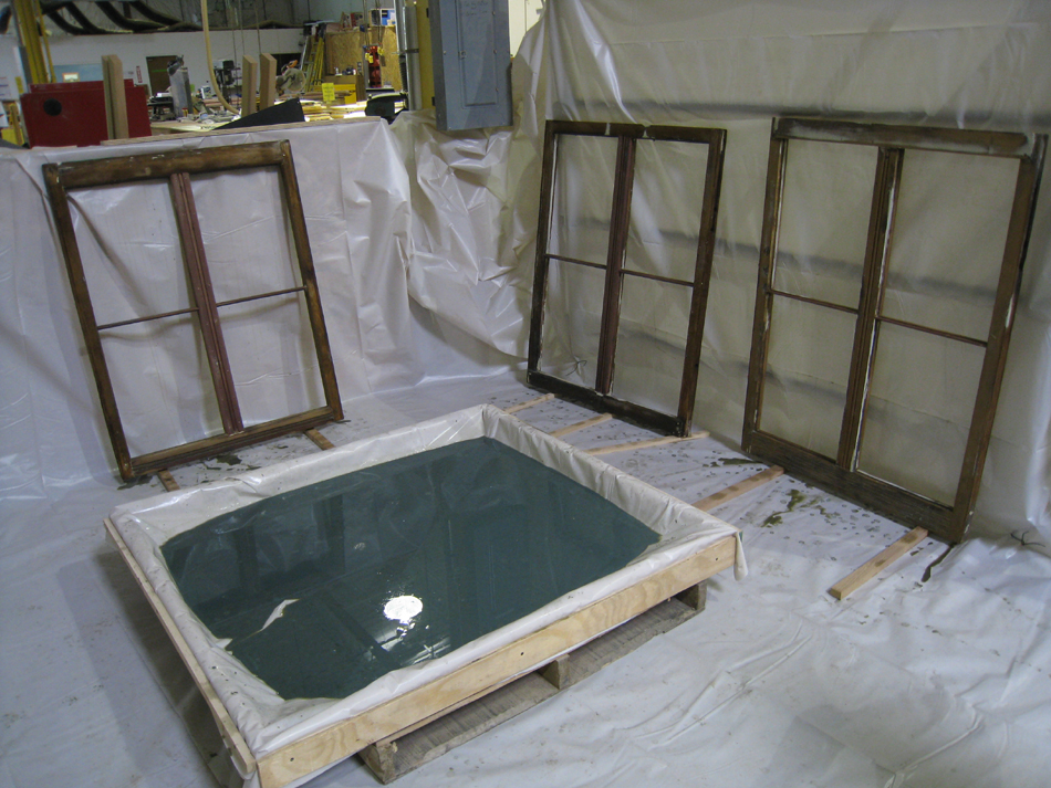 Doors and Windows -- SRS Corp. -- wood preservative bath being used prior to final sanding and priming.