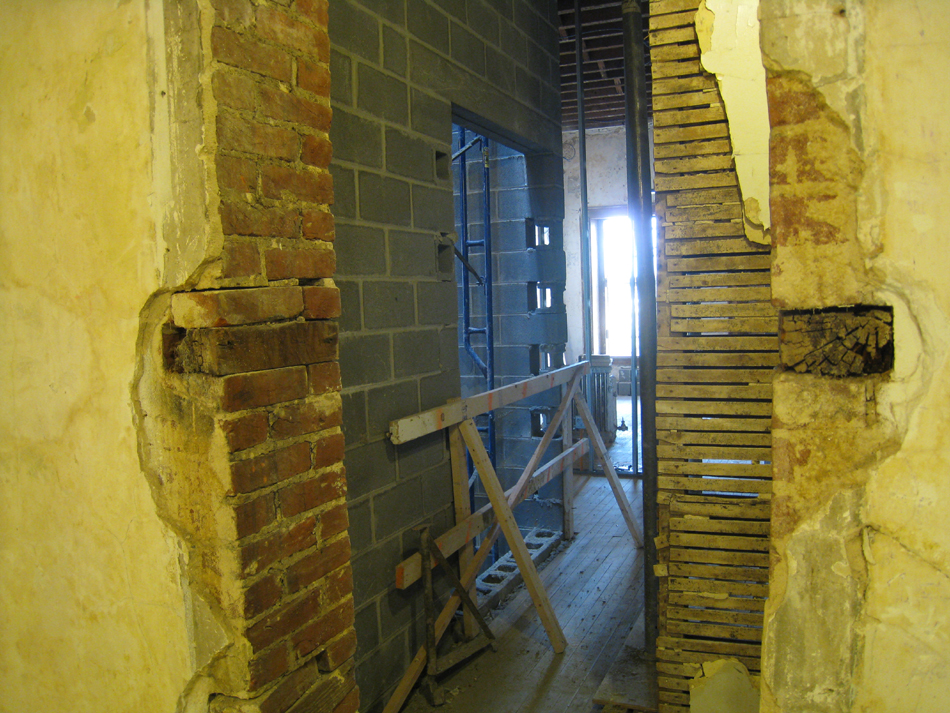 First Floor--From original staircase looking south west through to elevator shaft