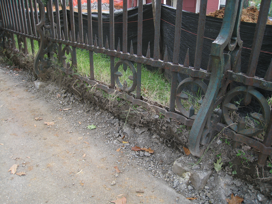 Fence--Detail--Removal of cement from bottom of fence on Pennsylvania Ave. side