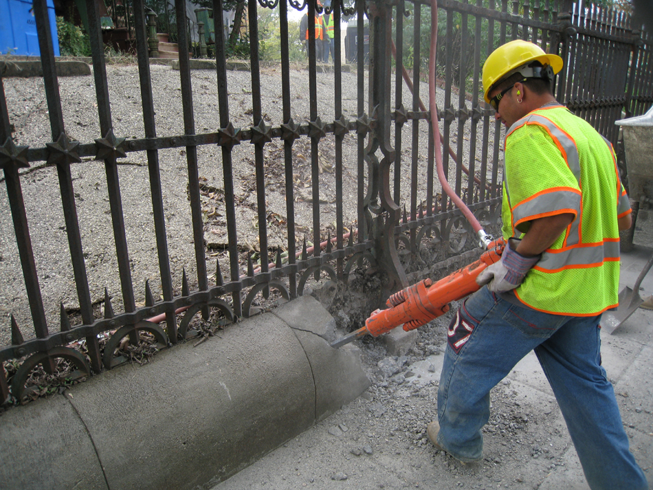 Fence--Removal of cement from bottom of fence on Pennsylvania Ave. side