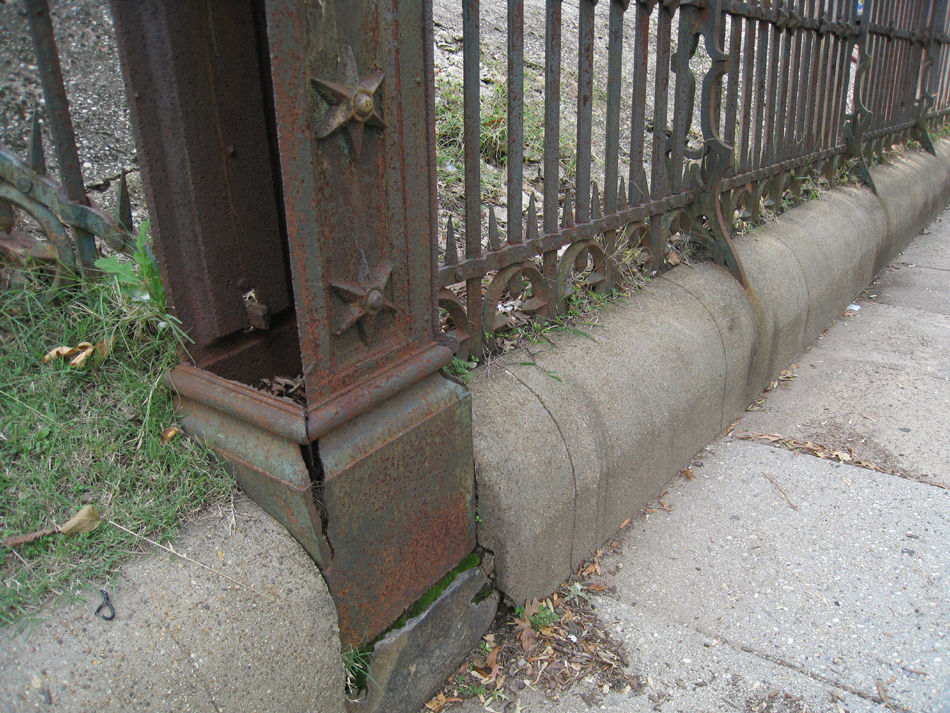 Fence--Detail--Removal of cement from bottom of fence on Pennsylvania Ave. side (northeast corner of fence)