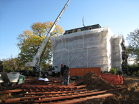 Miscellaneous--Stair elements being lifted into building through the elevator shaft - November 1, 2010