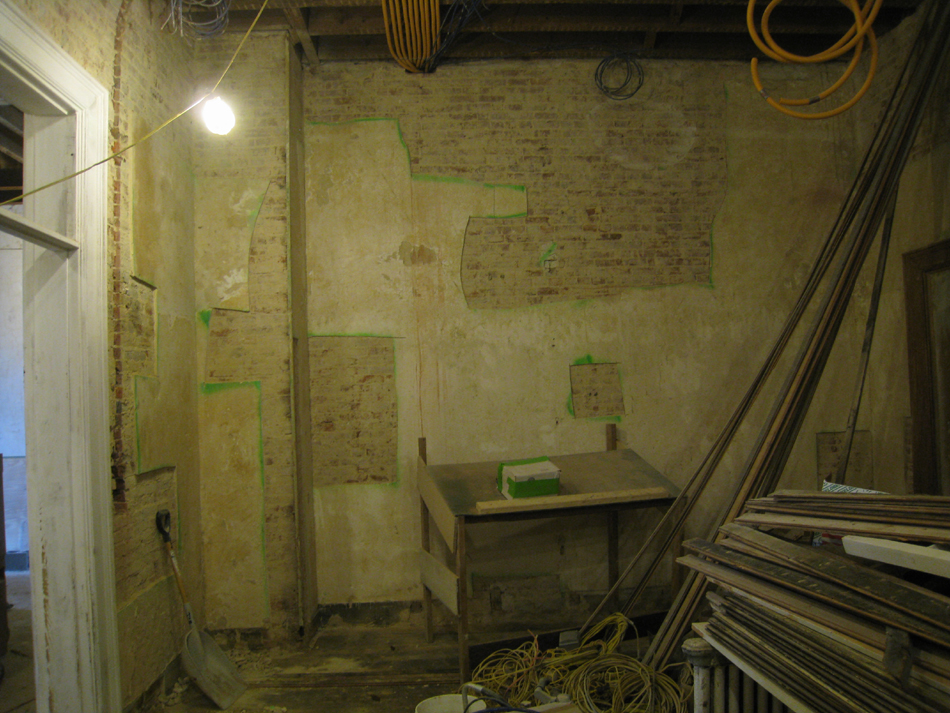 Second Floor--Northeast room--West wall.  Selective baring of wall for plaster replacement and restoration