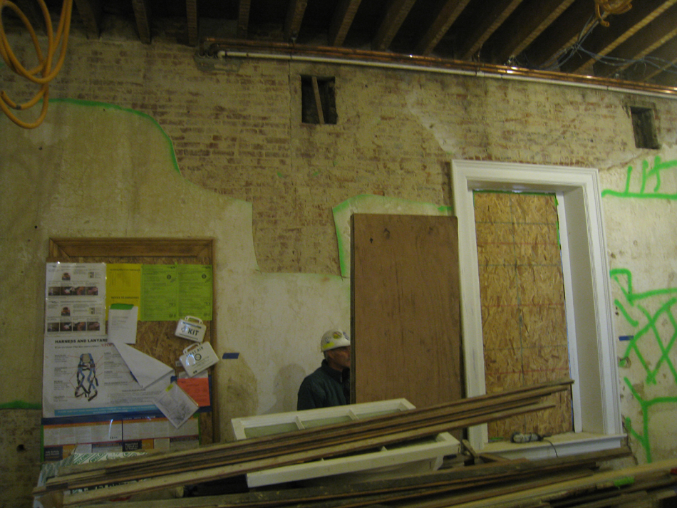 Second Floor--Northeast room--North wall.  Selective baring of wall for plaster replacement and restoration