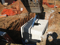 Geothermal/HVAC--Lowering vault sections into place - November 8, 2010