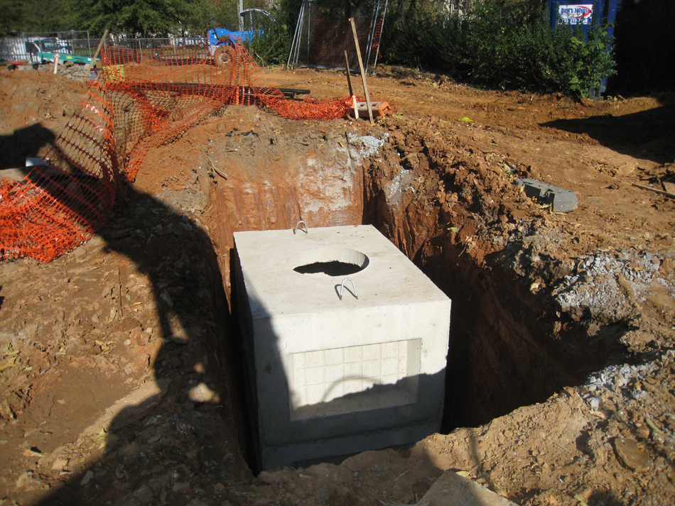 Geothermal/HVAC--Lowering vault sections into place