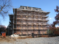 Elevation--East side after paint removal.  Worker preparing mortar joints for repointing - November 17, 2010