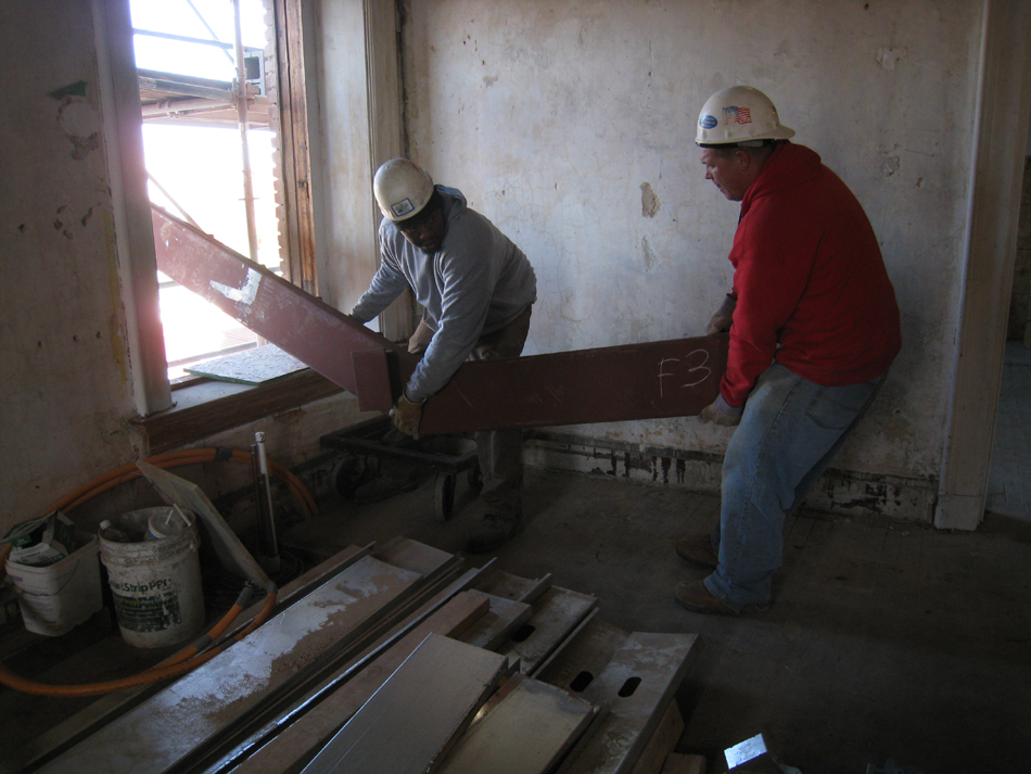 Second Floor--Lifting the parts for the east staircase into the building (through the west side corridor window)