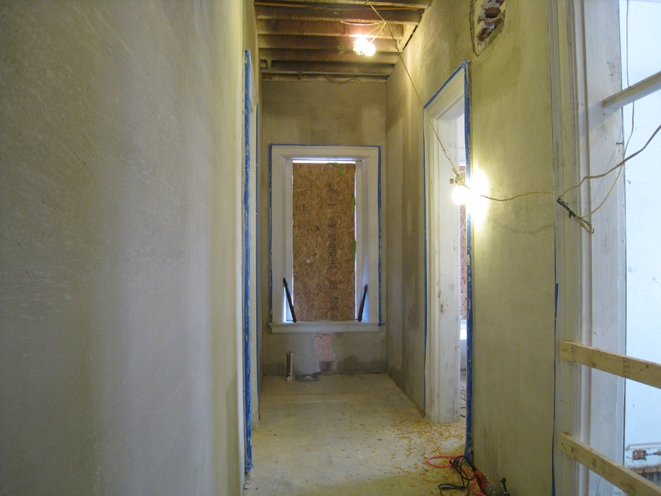 First Floor--Encapsulating plaster complete in the east corridor (ready for skim coat)