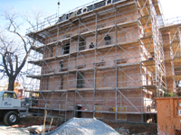 Miscellaneous--Lifting the parts for the east staircase into the building - November 19, 2010