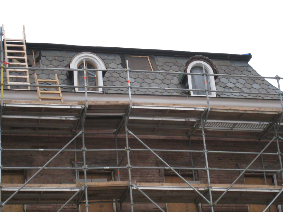 Elevation--West side showing restoration of third floor windows in progress