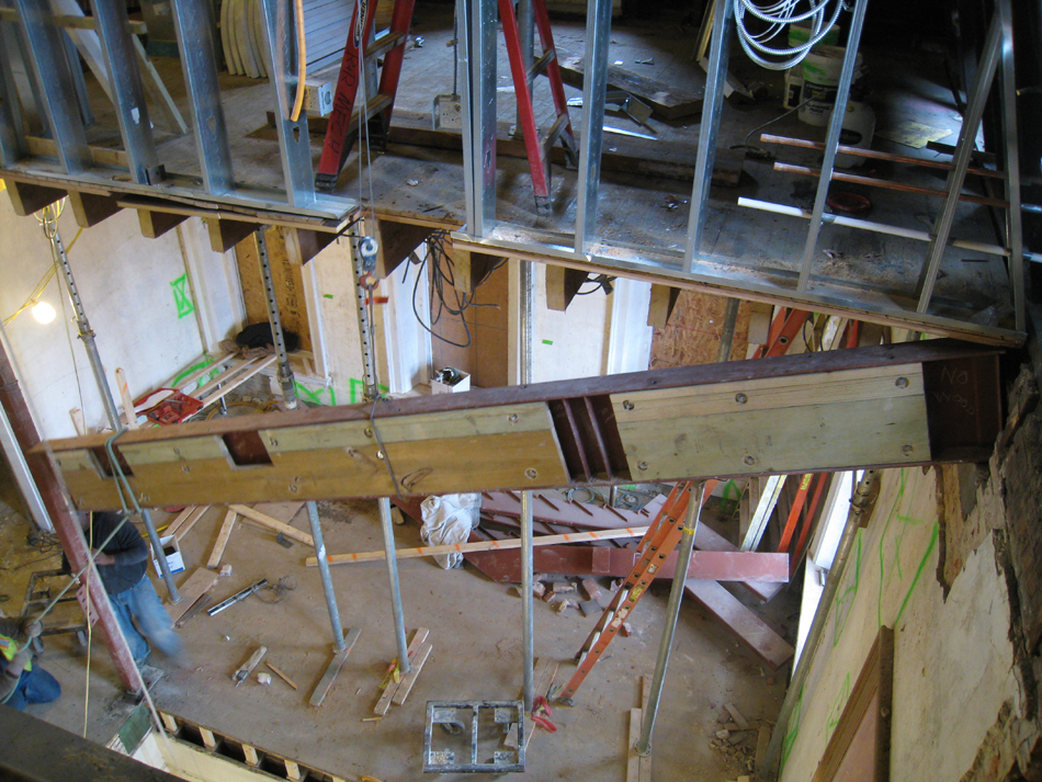 Third Floor--Looking down east stairwell as beam is being raised into place - December 28, 2010