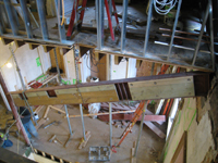 Third Floor--Looking down east stairwell as beam is being raised into place - December 2, 2010