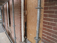 Elevation--West side, first floor, detail of restored window frames before priming - December 2, 2010
