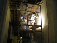 Second Floor--Central stairwell--Applying final plaster coat - January 7, 2011