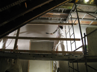 Second Floor--Applying final plaster coat in central stairwell - January 7, 2011