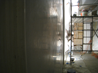 Second Floor--Applying final plaster coat in northeast room (so smooth it is like a mirror) - January 7, 2011