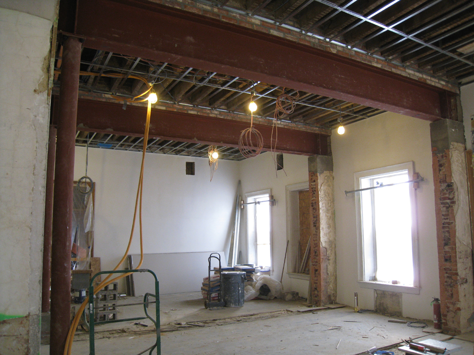 Second Floor--Large central room with large I-beams and finished plaster, with columns looking east - January 20, 2011