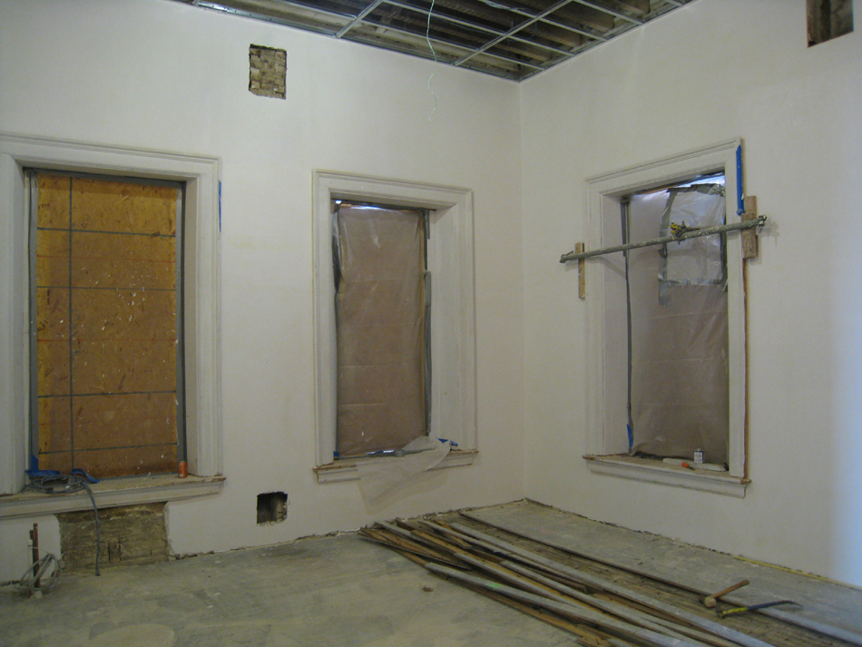Second Floor--Northwest corner room with original floor (left) exposed after removing later flooring (right) - January 20, 2011
