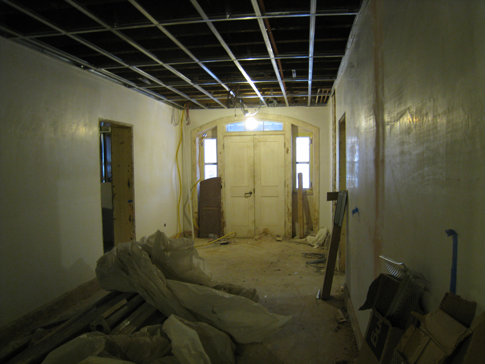 Ground Floor--New concrete floors and plaster in corridor looking south towards south exit - February 1, 2011