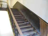 Third Floor--Sanded and unsanded railing for the central staircase (note the two alternating woods in the chair rail) - March 15, 2011