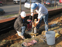 Fence--Drilling anchor holes in existing fence foundation for installation - March 18, 2011