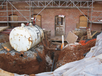 Elevation--West side, showing geothermal pipes entering building under what will become the main entrance - March 18, 2011