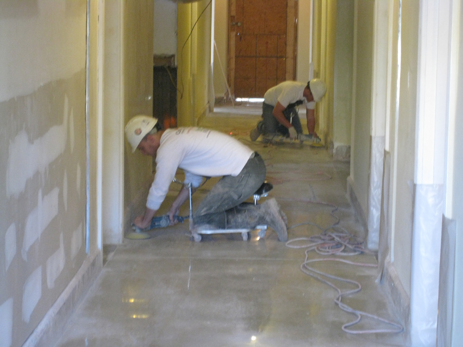 Ground Floor--Workers polishing the concrete corridor floor - April 29, 2011