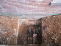 Elevation--View of foundation (in brick).  Pipes go under the foundation (not through).  South east side of building--water pipes - April 29, 2011
