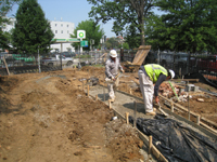 Grounds--Preparing for pouring concrete for sidewalk (north west corner) - June 10, 2011