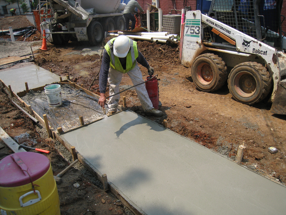 Grounds--Applying drying inhibitor to concrete - June 10, 2011