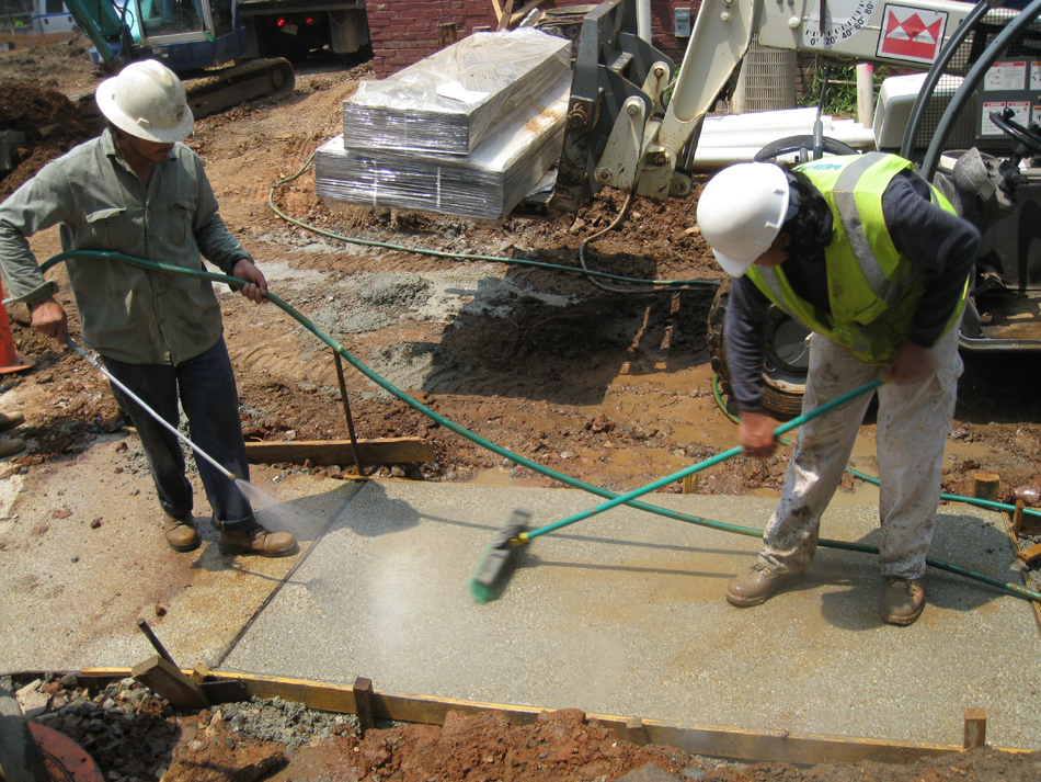 Grounds--Brushing and washing off top layer of concrete to expose small stone - June 10, 2011