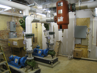 Ground Floor (Basement) --Mechanical room showing pumps for geothermal - July 9, 2011