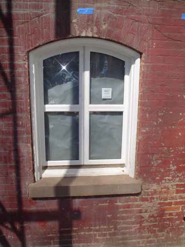 The basement casement windows, which have been refabricated according to what the  originals looked like, have arrived and were installed within the knuckle hinges.